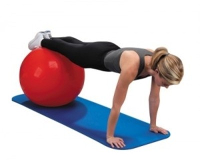 Photo of a female client performing a core exercise using a swiss ball.