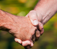 Image of a handshake symbolizing a fitness collaboration.