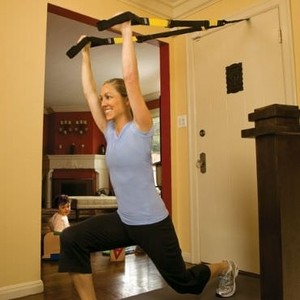 Image of a lady performing environmental fitness training in her home.