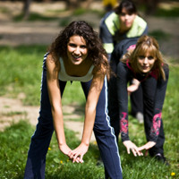 Image of participants engaging in an outdoor fitness training session.