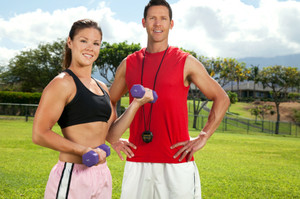 Image Of Two Outdoor Personal Trainers Striking A Pose.