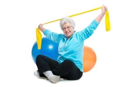 Image of a senior lady exercising with bands.
