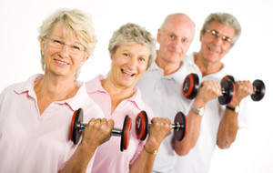 Photo of a group of senior citizens exercising with hand-weights.