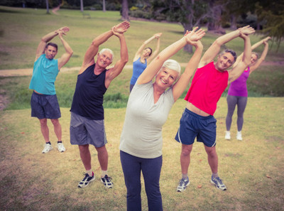 Image of a group of seniors exercising outdoors.