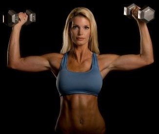 Image of female client performing a strength training routine.